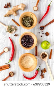 Cooking with spices, salt and pepper on kitchen table background top view
