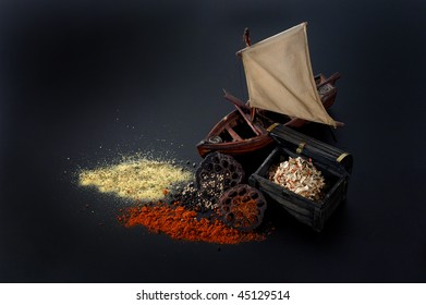 Cooking spices scattered and ship on table