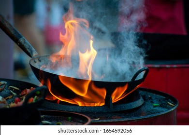 Cooking street food on a hot frying pan. Street food festival