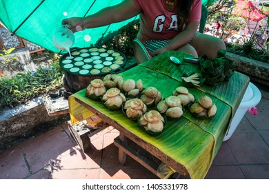 Cooking for Sweet and Savory Grilled Coconut-Rice Hotcakes it's for kanom krok but sometimes they use Coconut Rice Cake, Thai coconut pudding too. Luang Prabang, Laos - 14 January 2019.