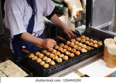 Cooking Takoyaki on hot pan - Takoyaki, Octopus dumplings Japanese Traditional food