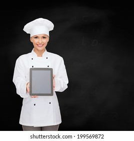 cooking, technology and food concept - smiling female chef, cook or baker with tablet pc computer blank screen