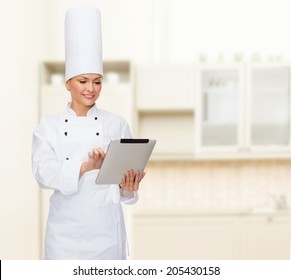 cooking, technology and food concept - smiling female chef with tablet pc computer