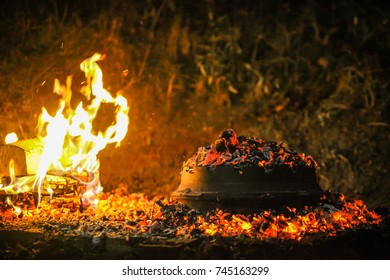 Cooking traditional balkan turkish bosnian dalmatian meal Peka in metal pots called sac sach or sache. Traditional roast of pork beef or veal. Sac is covered with hot charcoal.