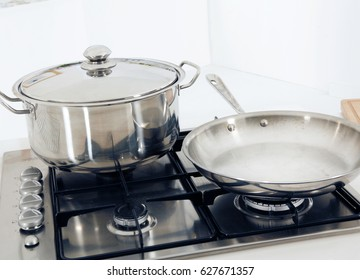 COOKING UTENSILS ON OVEN