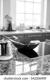 Cooking utensils on stove in kitchen