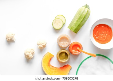 cooking vegetable puree for baby on white background top view
