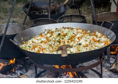 Cooking vegetables in cauldron pan