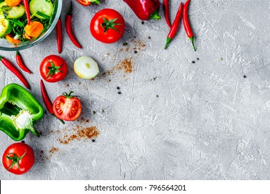 cooking vegetables on the stone background top view