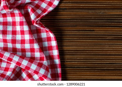 Cooking wooden table with kitchen towel or napkin. Top view with space for your meal or recipe