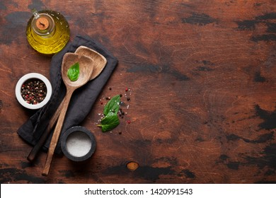 Cooking wooden utensils and spices on wooden kitchen table. Food cooking template concept. Top view with copy space. Flat lay
