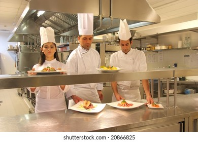 cooks in a kitchen of a restaurant