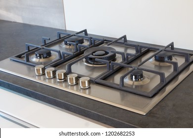 Cooktop with five burners in a modern kitchen