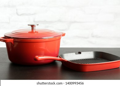 Cookware set: Red enameled cast iron pot, saucepan