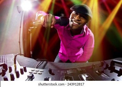 Cool African American male DJ playing music at a party