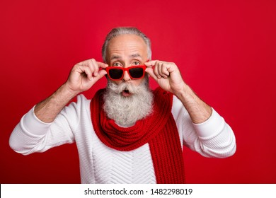 Cool aged santa man read xmas sale prices not believe eyes wear sun specs knitted jumper isolated red background