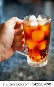 Cool americano, coffee, ice cubes, glass.