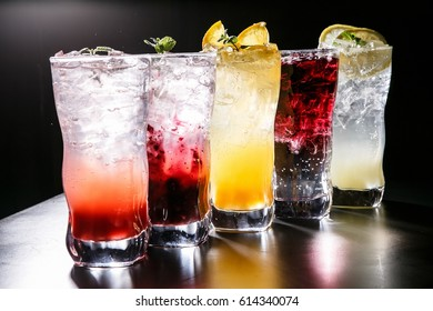 cool assorted ade with glass on table