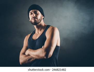 Cool bad boy with strong attitude posing arms crossed