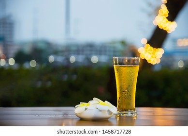 Cool beer glass in twilight - relax with beer in garden concept