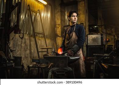 Cool blacksmith portrait in workshop