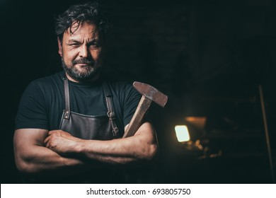 Cool blacksmith portrait in workshop