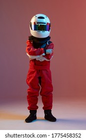 Cool boy child racer in helmet, racing suit, standing in neon light. Kart racing school poster. Competition announcement