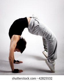 Cool break dance style dancer standing on arms