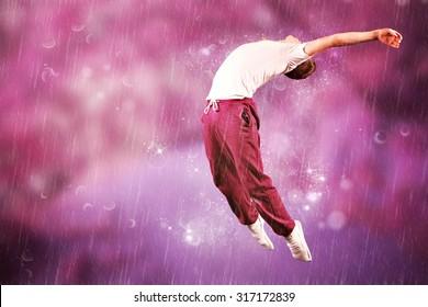 Cool break dancer against purple coloured forest