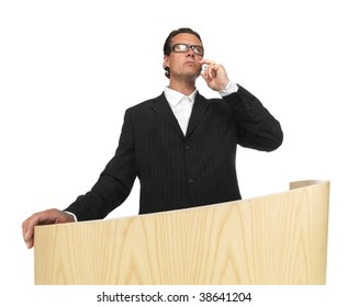 Cool businessman on lectern on isolated white