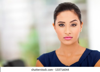 cool businesswoman in office close up
