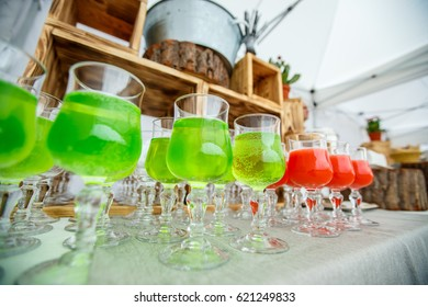 Cool colored drinks in the glasses on the table.
