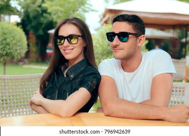 Cool Couple Wearing Matching Trendy Fashion Sunglasses. Funny boyfriend and girlfriend with similar specs having fun dating