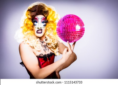 cool drag queen with spectacular makeup, glamorous stylish look, posing with   proud and  style for lgtb equality gay rights with disco ball