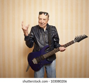 cool fashion elder man with electric guitar