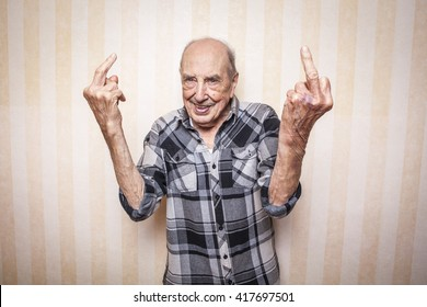 cool funny elder man making middle finger sign