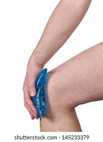 Cool gel pack on a swollen hurting knee. Male holding hand to spot of neck-aches.