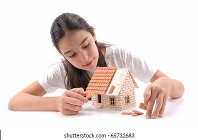 Cool girl building house isolated on white - a series of BUILDING A HOUSE images.