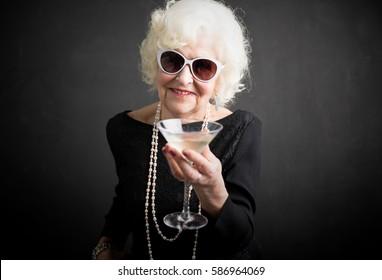 Cool grandma having a drink