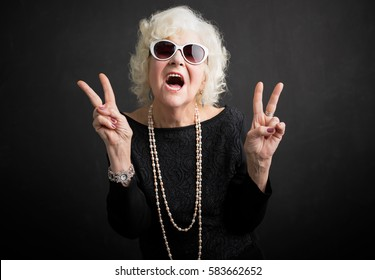 Cool grandma showing peace sign