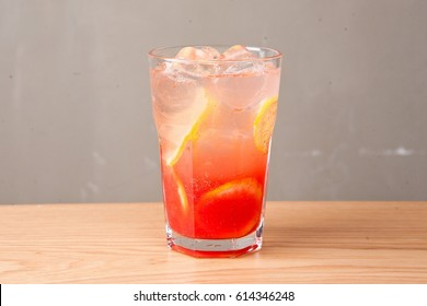 cool grapefruit ade with glass on table