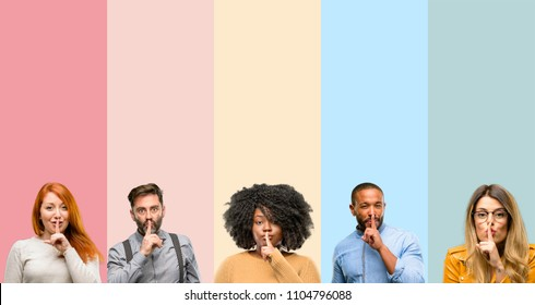 Cool group of people, woman and man with index finger on lips, ask to be quiet. Silence and secret concept