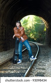 Cool guitarist portrayed inside a railway tunnel