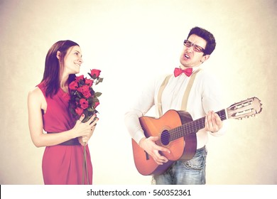 cool guy winning His Woman with a sweet serenade in a valentine's day