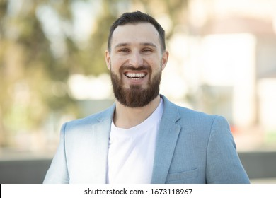 Cool handsome guy with beard smiling.
