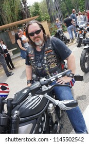 Cool Harley-Davidson biker at the Harley-Davidson rally of Saint Tropez, port Grimaud, Provence/France - May 10 - 2014