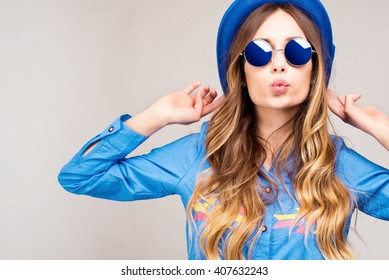 Cool hipster student woman wearing eyewear glasses . Caucasian female university student looking at camera smiling happy. - Shutterstock ID 407632243