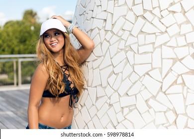 Cool hipster student woman wearing eyewear glasses and baseball cap