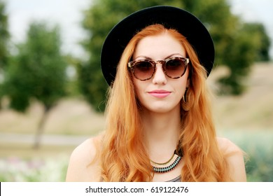 Cool hipster student woman wearing eyewear glasses. Fashion funny glamor stylish sexy smiling beautiful young woman model in summer clothes walking in the street
