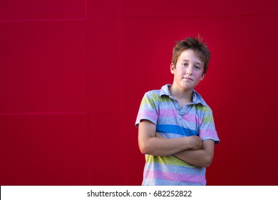 Cool Kid on a red background, arms folded